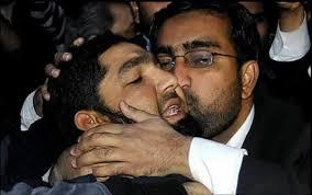 Qadri's assassin is hugged (Credit: visitpak.com)