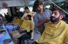 Taliban at barbers (Credit: gulfnews.com)