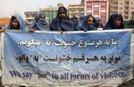 Burqa clad Afghan men (Credit: fedgeno.com)
