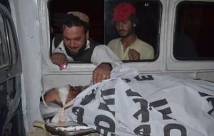 Pashtun looks at deceased relative (Credit: washingtonpost.com)